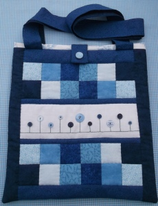 A beautiful Blue buttoned bag! AND...just as beautiful on the back too!!